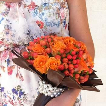 "Créditos: <a href=""http://zankyou.9nl.de/ikpl"" target=""_blank""> Flores à la Carte  </a>"