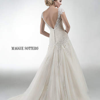 "Beaded embroidered lace on tulle adorns this demure drop-waist A-line gown, featuring detachable front modesty panel and detachable lace cap-sleeves. Finished with covered buttons and zipper over inner elastic back closure.  <a href=""http://www.maggiesottero.com/dress.aspx?style=4MS948CS"" target=""_blank"">Maggie Sottero Platinum 2015</a>"