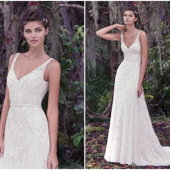 "Dreamy and alluring, this A-line wedding dress features a Vogue satin slip and an intricately embroidered overlay with lace. A plunging V-back and beaded belt completes this romantic gown. Finished with covered buttons over zipper closure.   <a href=""https://www.maggiesottero.com/maggie-sottero/jorie/9704"" target=""_blank"">Maggie Sottero</a>"