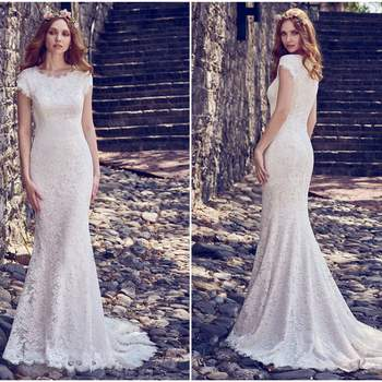 "Allover lace comprises this romantic fit-and-flare wedding dress, featuring a jewel neckline and cap-sleeves. Lined with Inessa Jersey for a luxe fit. Finished with zipper closure. Detachable Fallow Organza overskirt with Swarovski crystal waistband sold separately.  <a href=""https://www.maggiesottero.com/maggie-sottero/raylene/11188?utm_source=zankyou&amp;utm_medium=gowngallery"" target=""_blank"">Maggie Sottero</a>"