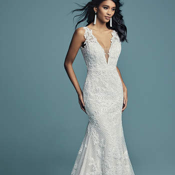 "<a href=""https://www.maggiesottero.com/maggie-sottero/hailey/11268"">Maggie Sottero</a>  Lace motifs cascade over crosshatch and tulle in this unique fit-and-flare wedding gown, completing the bodice. Featuring an illusion plunging V-neckline, straps, and square back. Lined with shapewear for a flattering fit, and finished with covered buttons over zipper closure. Detachable tulle overskirt accented with an attached beaded belt sold separately."
