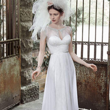 "Sparkling Swarovski crystals adorn the illusion keyhole neckline and cap-sleeves in this elegant sheath wedding dress, accented with demure illusion lace back. Finished with thin belt at the waist, covered buttons and zipper closure.  <a href=""http://www.maggiesottero.com/dress.aspx?style=5MT687"" target=""_blank"">Maggie Sottero</a>"