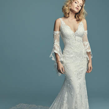 "<a href=""https://www.maggiesottero.com/maggie-sottero/lucienne-marie/11278"">Maggie Sottero</a>  Embroidered lace motifs waltz over dotted tulle in this boho sheath wedding dress, completing the illusion sweetheart neckline and illusion scoop back. Featuring a breathtaking illusion double-train accented in lace motifs, and lined with Cypress Jersey for a luxe fit. Finished with covered buttons over zipper closure. Detachable illusion poet sleeves accented in lace motifs sold separately."