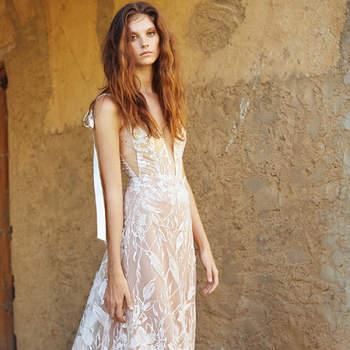 Vestido de novia de tirantes con detalles de lazada en la espalda.