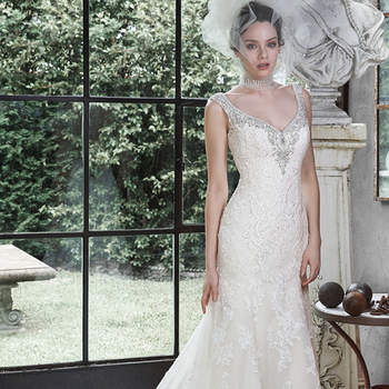 "This sophisticated lace and tulle A-line wedding dress is sweetened with glittering Swarovski crystals and pearls encrusting the V-neckline, tank straps and dramatic V-back. Finished with pearl buttons and zipper over inner corset closure.  <a href=""http://www.maggiesottero.com/dress.aspx?style=5MW646"" target=""_blank"">Maggie Sottero</a>"