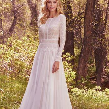"Understated elegance is found in this subtle lace and Santorini chiffon A-line wedding dress, complete with bateau neckline and long sleeves. Lace is fully lined with Inessa jersey for demure coverage. Finished with zipper closure. <a href=""https://www.maggiesottero.com/maggie-sottero/deirdre-marie/10156?utm_source=mywedding.com&amp;utm_campaign=spring17&amp;utm_medium=gallery"" target=""_blank"">Maggie Sottero</a>"