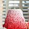 Tarta de bodas cuajada de flores de azúcar en ofecto ombré de color rosa. Foto: Janet Mohapi-Banks