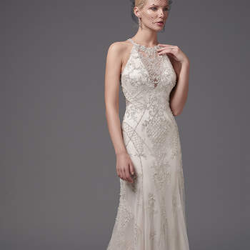 "Shimmering beaded lace appliqués and crosshatching add luster and dimension to this glamorous sheath, highlighting the waistline, illusion halter over V-neck, and illusion open back. Embellished lace hem completes the gown's striking lines. Finished with crystal buttons over zipper closure.  <a href=""https://www.maggiesottero.com/sottero-and-midgley/felicia/10220?utm_source=mywedding.com&utm_campaign=spring17&utm_medium=gallery"" target=""_blank"">Sottero and Midgley</a>"
