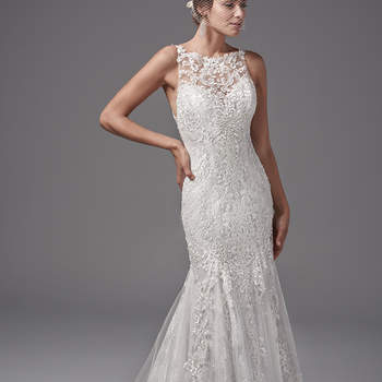 "Featuring layers of lace appliqués, this fit-and-flare evokes sophisticated romance. Chic lace-appliquéd straps complete the illusion sweetheart neckline and statement illusion-back, while tulle godets and lines of lace appliqués flow into a breathtaking skirt. Finished with covered buttons and zipper closure.  <a href=""https://www.maggiesottero.com/sottero-and-midgley/juno/10233?utm_source=mywedding.com&utm_campaign=spring17&utm_medium=gallery"" target=""_blank"">Sottero and Midgley</a>"