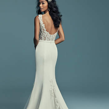 "<a href=""https://www.maggiesottero.com/maggie-sottero/jayleen/11430"">Maggie Sottero</a>  This unique wedding dress features a bodice accented in beaded lace motifs, completing the illusion bateau neckline and straps, a sheer scoop back with crosshatch detail. Aldora Crepe fit-and-flare skirt features tulle and lace godets at the sides and back, all accented in lace motifs. Completed with an Aldora crepe belt. Finished with covered buttons and zipper closure."