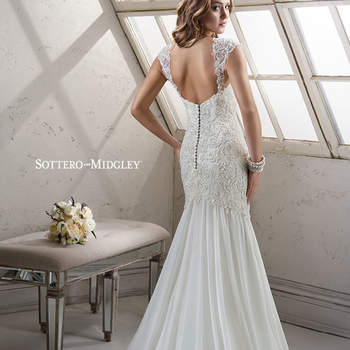 "Beautifully embellished beaded lace on tulle adorns Paris chiffon in this classic slim A-line, finished with romantic sweetheart neckline. Finished with covered button and zipper over inner corset back closure.  <a href=""http://www.sotteroandmidgley.com/dress.aspx?style=4SS991"" target=""_blank"">Sottero &amp; Midgley Platinum 2015</a>"