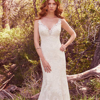 "This elegant fit-and-flare features cascades of lace appliqués and a striking hemline. Scalloped lace illusion trims the deep V-neck and straps, and lines of lace appliqués accent the illusion back. Finished with covered buttons over zipper closure.  <a href=""https://www.maggiesottero.com/maggie-sottero/venita/10150?utm_source=mywedding.com&amp;utm_campaign=spring17&amp;utm_medium=gallery"" target=""_blank"">Maggie Sottero</a>"