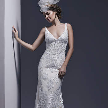 "Timeless and elegant is this seductive sheath dress of stunning bold lace atop tulle, accented with tank straps and deep V-neckline and back. Finished with covered buttons over zipper closure.   <a href=""http://www.sotteroandmidgley.com/dress.aspx?style=5SS638"" target=""_blank"">Sottero &amp; Midgley</a>"