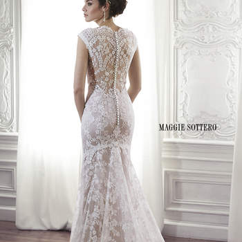 "Made from exquisite floral lace, this sheath gown is the epitome of romance. Complete with scalloped lace neckline and illusion lace back. Finished with covered button over zipper back closure.  <a href=""http://www.maggiesottero.com/dress.aspx?style=5MC013"" target=""_blank"">Maggie Sottero Spring 2015</a>"