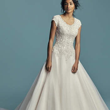 "<a href=""https://www.maggiesottero.com/maggie-sottero/eden-marie/11471"">Maggie Sottero</a>  This modest princess wedding dress features a bodice of beaded lace motifs accented in Swarovski crystals, trailing into a ballgown skirt comprised of tulle. Featuring a scoop neckline, cap-sleeves, and subtle V-back. Finished with covered buttons over zipper closure."