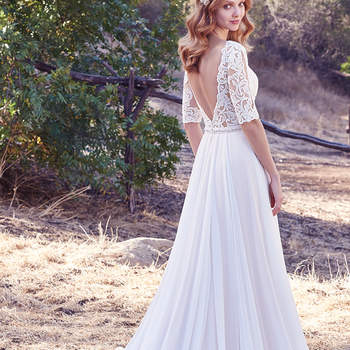 This Aurora Chiffon A-line features a lace bodice with illusion elbow sleeves and illusion bateau neckline accented in lace appliqués. A Swarovski crystal belt motif and plunging V-back add touches of alluring romance. Finished with covered buttons over zipper closure.