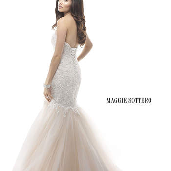 "A return to romance is found in this fit and flare gown. Beaded embroidered lace on a tulle bodice features sparkling Swarovski crystals, while a bouquet of handmade flowers accent a Venice Organza skirt. Finished with corset back closure.  <a href=""http://www.maggiesottero.com/dress.aspx?style=4MW891"" target=""_blank"">Maggie Sottero Platinum 2015</a>"