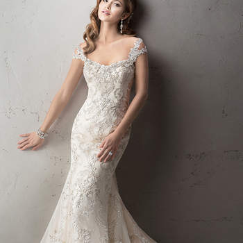Exquisite beaded embroidered lace on tulle drapes over delustered satin in this fit and flare gown featuring dazzling Swarovski crystals on the neckline and shoulder straps. Complete with scoop neckline and finished with crystal button and zipper over inner corset closure. Optional detachable, cold shoulder cap-sleeves. <img height='0' width='0' alt='' src='http://ads.zankyou.com/mn8v' />