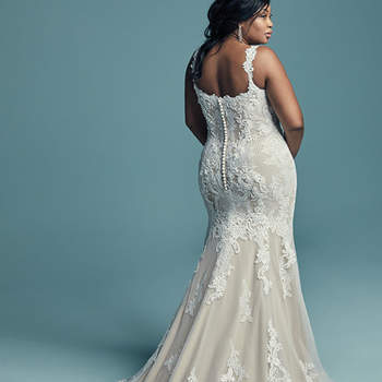 "<a href=""https://www.maggiesottero.com/maggie-sottero/abbie-lynette/11451"">Maggie Sottero</a>  This elegant fit-and-flare wedding dress offers additional coverage to our Abbie style, featuring embroidered lace motifs and crosshatching dance over tulle. Chic lace straps glide from the illusion plunging sweetheart neckline to the scoop back, all accented in beaded lace motifs. Lined with shapewear for a figure-flattering fit. Finished with covered buttons over zipper closure."