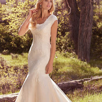 "Classic and elegant, this modest fit-and-flare features layers of lace appliqués over airy tulle, a scalloped lace hemline, cap-sleeves, and a scoop neckline. Finished with covered buttons over zipper closure.  <a href=""https://www.maggiesottero.com/maggie-sottero/brielle/10165?utm_source=mywedding.com&amp;utm_campaign=spring17&amp;utm_medium=gallery"" target=""_blank"">Maggie Sottero</a>"