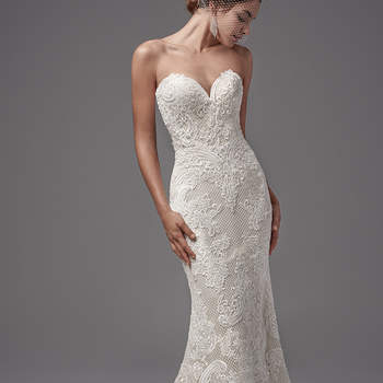 """This intriguing fit-and-flare features crosshatch netting and luxurious lace appliqués. Flourishes in the lace pattern evoke a basque waistline. Complete with sexy sweetheart neckline and open V-back. Finished with covered buttons over zipper closure. "" <a href=""https://www.maggiesottero.com/sottero-and-midgley/ellington/10217?utm_source=mywedding.com&utm_campaign=spring17&utm_medium=gallery"" target=""_blank"">Sottero and Midgley</a>"