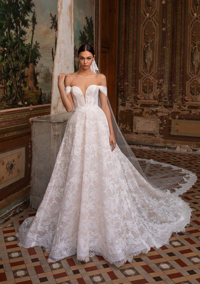 Vestido de novia hombros caídos corte princesa