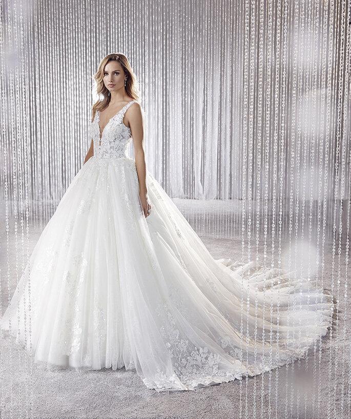 Osmoz Mariage - un modèle portant une robe Kelly Supreme de chez Osmoz Mariage