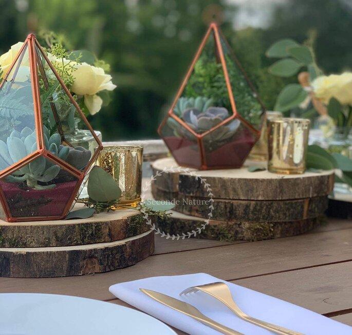 Eléments de décoration floraux - troncs d'arbres pour un mariage champêtre