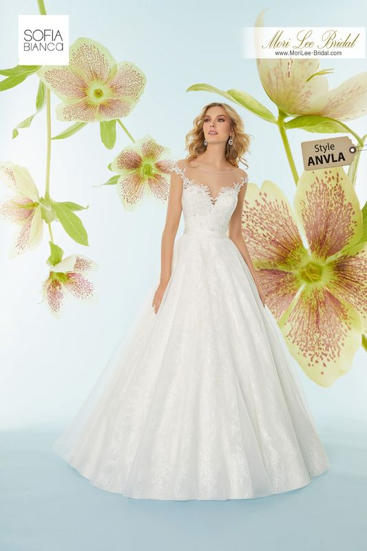 Style ANVLA Samantha  Crystal beaded, embroidered appliqués meet satin waistband with organza over chantilly lace skirt
