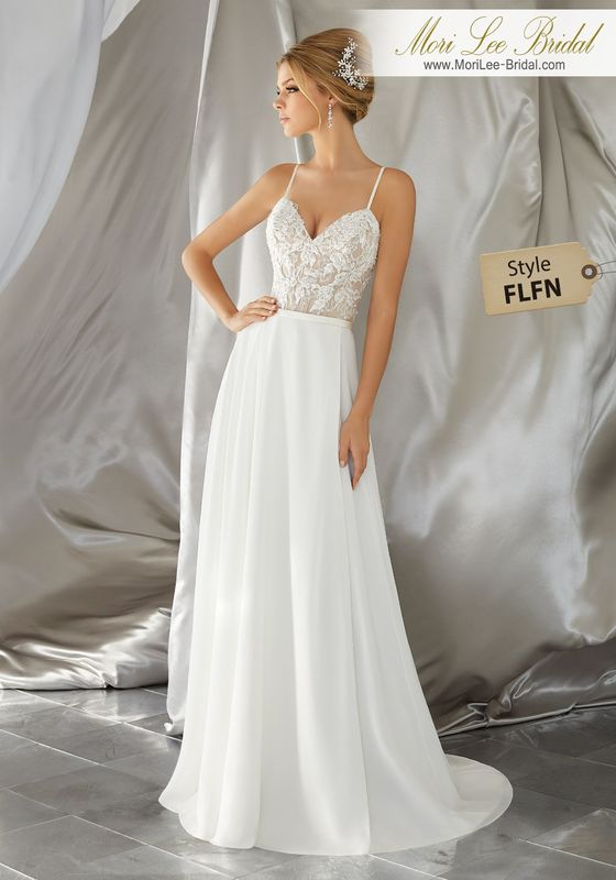 Style FLFN Mina Wedding Dress  Intricate Crystal Beaded Embroidery Meets a Flowing, Soft Chiffon Skirt. Delicate Straps and Corset Style Back Complete the Look. Matching Satin Bodice Lining Included. Colors Available: White, Ivory, Ivory/Nude.