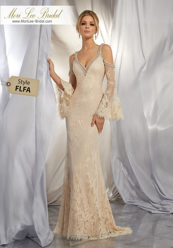Style FLFA Marion Wedding Dress  This Boho Inspired Gown Beautifully Combines Romantic Allover Chantilly Lace with a Brilliantly Beaded Neckline and Cold Shoulder Detail. A Scalloped Hemline and Bell Sleeves Complete the Look. Colors Available: Ivory, Nude.