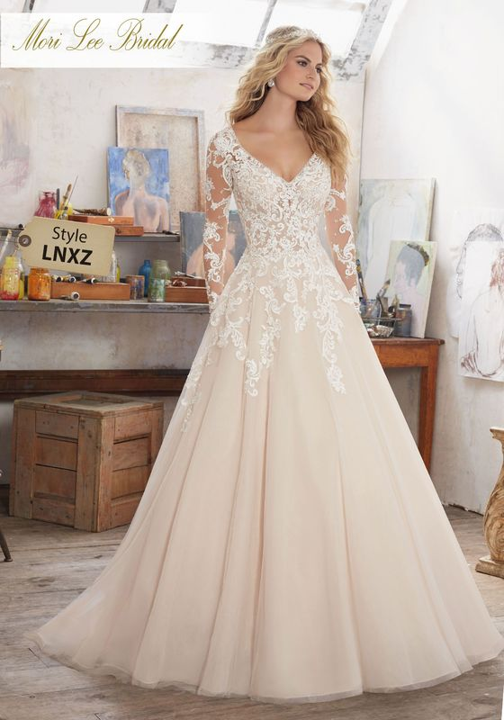 Dress style LNXZ Maira Wedding Dress Colors Available: White, Ivory, Ivory/Caramel. Shown in Ivory/Caramel.