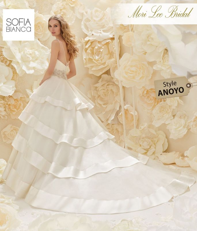 Style ANOYO A RUCHED ORGANZA BODICE WITH BEADED WAISTBAND AND SHOULDERS ON A TIERED SKIRT TRIMMED WITH SATIN     AVAILABLE IN 3 LENGTHS: 55, 58 AND 61'    COLOURS WHITE / SILVER OR IVORY / SILVER