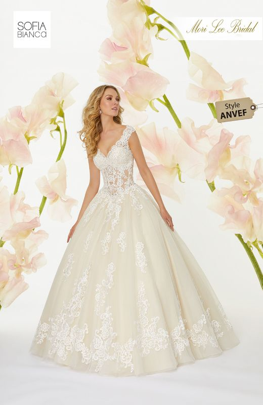 Style ANVEF Sydney  Crystal beaded, embroidered lace appliqués on a boned, corset bodice with tulle ball gown skirt  Matching satin bodice lining included