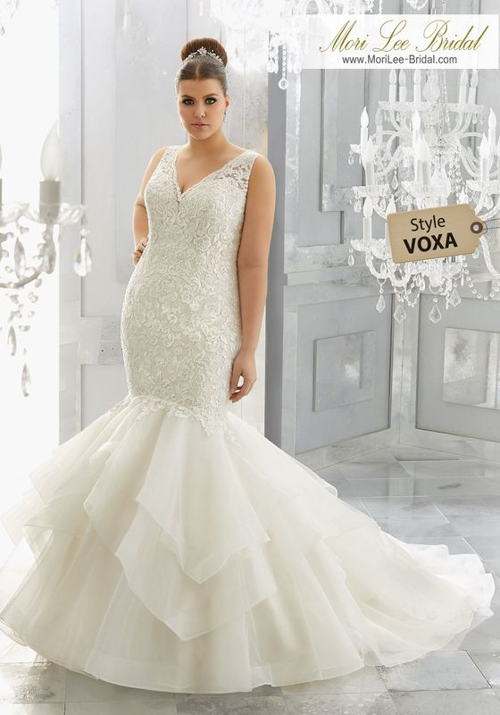 Style VOXA Miliana Wedding Dress  Glamourous Form Fitting Tulle Mermaid with Flounced Skirt and Crystal Beaded, Embroidered Appliqués Adorning the Bodice. Available in Three Lengths: 55″, 58″, 61″. Colors Available: White, Ivory, Ivory/Light Gold.