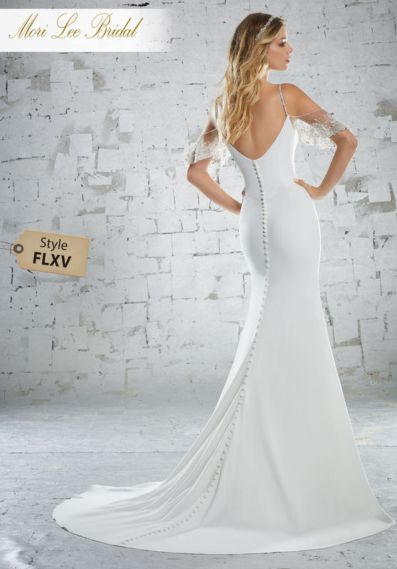 Style FLXV Karlotta Wedding Dress  Chic Form Fitting Crepe Gown with Crystal Moonstone Beaded, Flutter Sleeves and Straps. Covered Buttons Trim the Entire Back and Train. Colors Available: White, Ivory