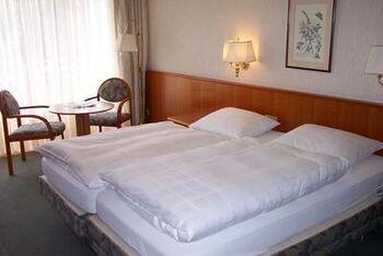 Beispiel: Zimmer, Foto: Eden Parc Hotel.
