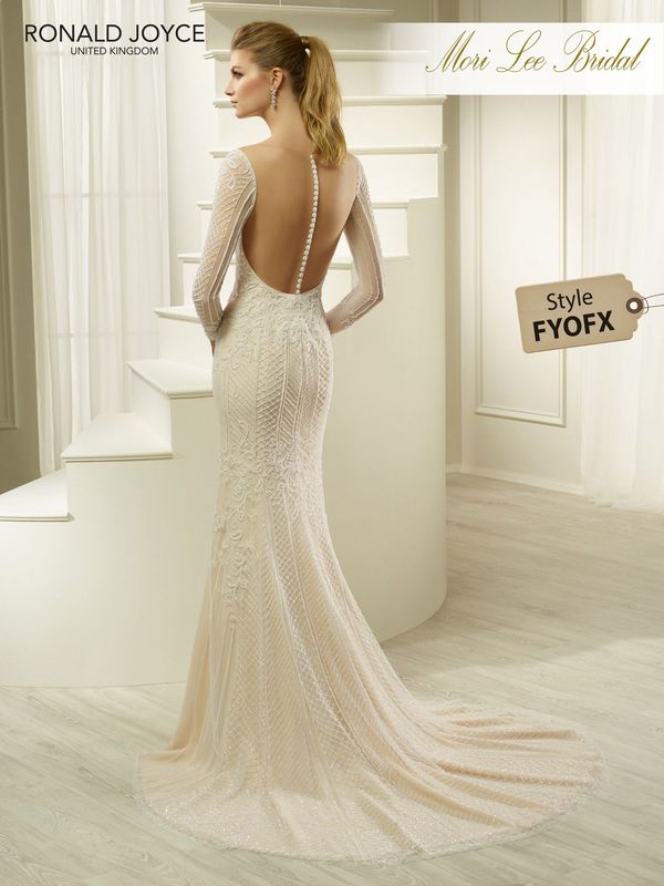 Style FYOFX HATSY A TULLE AND CHIFFON DRESS WITH DELICATE BEADING, SLEEVES AND AN ILLUSION CUT-OUT BACK. PICTURED IN IVORY/NUDE.   AVAILABLE IN 3 LENGTHS: 55', 58' AND 61'   COLOURS IVORY, IVORY/NUDE