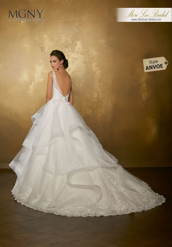 Style ANVOE Olivia  Embroidered lace appliqués on a horsehair edged, flounce ball gown with wide hemlace