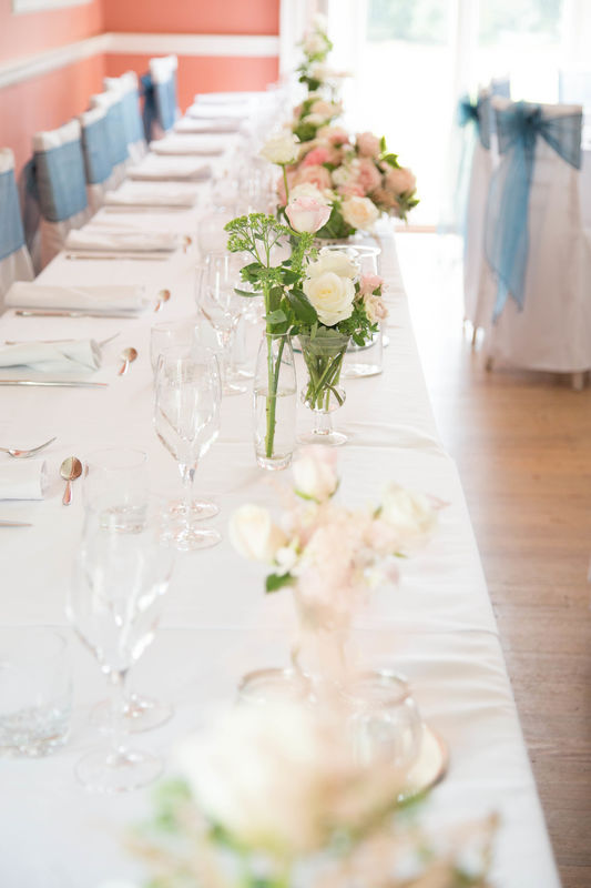 Top table. Rectangular top table, bud style vases of summer flowers