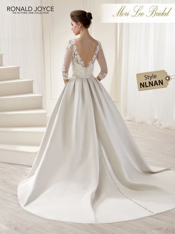 Style NLNAN LETISHA  A V-NECK BALL GOWN WITH A SATIN SKIRT, LACE DETAILED BODICE, ¾ LENGTH SLEEVES AND A WAISTBAND BOW. PICTURED IN OYSTER.  COLOURS WHITE, IVORY, OYSTER