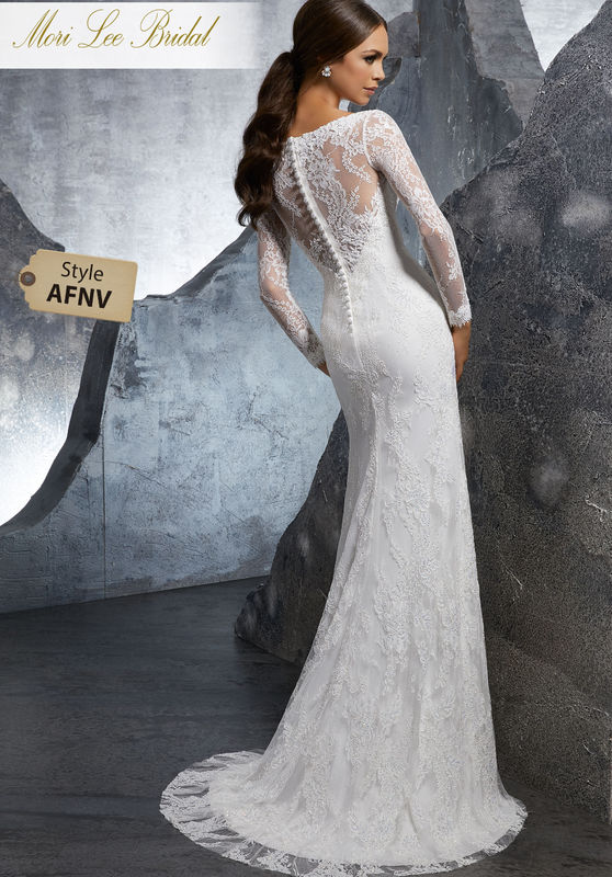 Style AFNV Kimi Wedding Dress  Fitted Long Sleeve Wedding Dress Featuring Crystal Beaded Alençon Lace Appliqués with Venice Lace Trim. A Zipper Back Closure Trimmed in Covered Buttons Completes The Look. Colors Available: White, Ivory, Ivory/Nude