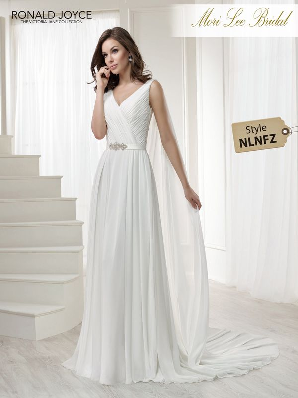 Style NLNFZ LAVINIA A CHIFFON AND SATIN SHEATH DRESS WITH A RUCHED V-NECK BODICE AND BEADED BELT DETAIL. DRESS COMES WITH A DETACHABLE MATCHING SHOULDER DRAPE AND MATCHING SHORT SLEEVES (NOT PICTURED). PICTURED IN IVORY.    COLOURS WHITE, IVORY