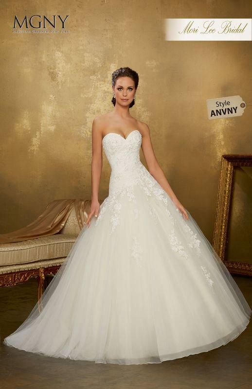 Style ANVNY Ondria  Crystal beaded alençon lace appliqués on an asymmetrically draped tulle ball gown