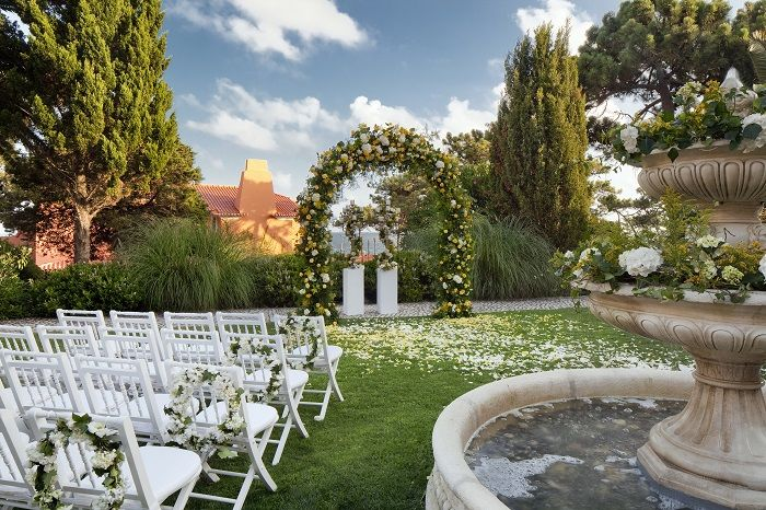Real Destination Wedding Ceremony with Floral Arch in The Fountain Garden in the Senhora da Guia Hotel, in cascais, Portugal