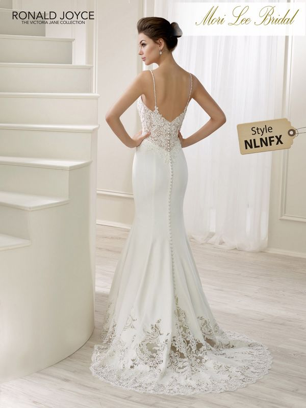 Style NLNFX LIBERTY  A CREPE FISHTAIL DRESS WITH A LACE EMBROIDERED BODICE AND SCALLOPED HEMLINE, BUTTON BACK DETAIL AND THIN SHOULDER STRAPS. PICTURED IN ALMOND/IVORY.  AVAILABLE IN 3 LENGTHS: 55', 58' AND 61'   COLOURS ALMOND/IVORY, IVORY