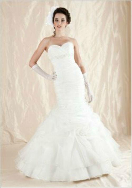 Beispiel: Brautkleid, Foto: Casanova Braut- und Abendmode.