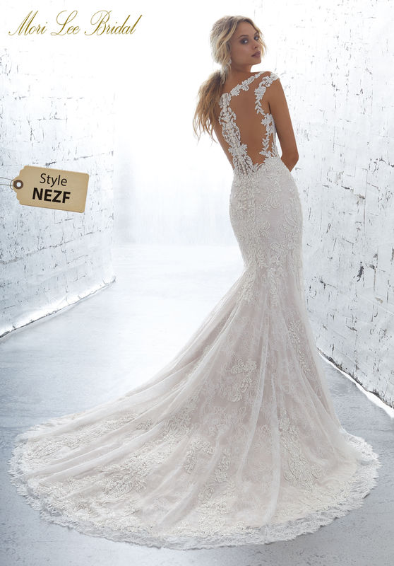 Style NEZF Kiana Wedding Dress  Moonstone and Crystal Beaded, Embroidered Appliqués Accent This Romantic Fit and Flare Chantilly Lace Wedding Dress. A Sheer Illusion Neckling and Scalloped Hemline Complete the Look. Available in Three Lengths: 55″, 58″, 61″. Colors Available: White, Ivory, Ivory/Rosé