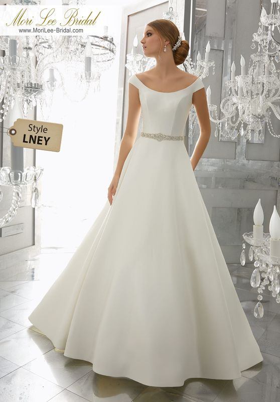 Style LNEY Marquesa Wedding Dress  Classic and Chic, This Marcella Satin A-Line Wedding Dress Features an Elegant Off-the Shoulder Neckline and Removable Diamanté Beaded Belt. Belt Also Sold Separately as Style NXOFN. Colors Available: White, Ivory.