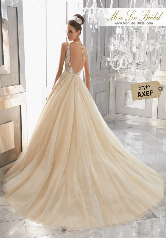Style AXEF Miya Wedding Dress  This Dreamy Bridal Ballgown Features a Delicate Crystal Beaded and Embroidered Sheer Bodice Paired with a Silky Net Ball Gown Finished in Ribbon Edging. Matching Satin Bodice Lining Included. Colors Available: White|Ivory|Champagne.